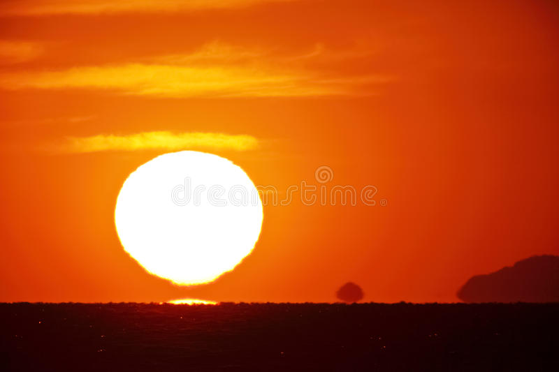 Bright big sun on the sky. With yellow orange red gradation colors, 500mm + teleconverter(×2 royalty free stock images