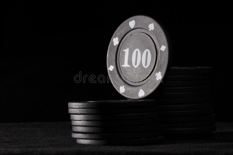 Bright black poker chip on top of the column stock photography