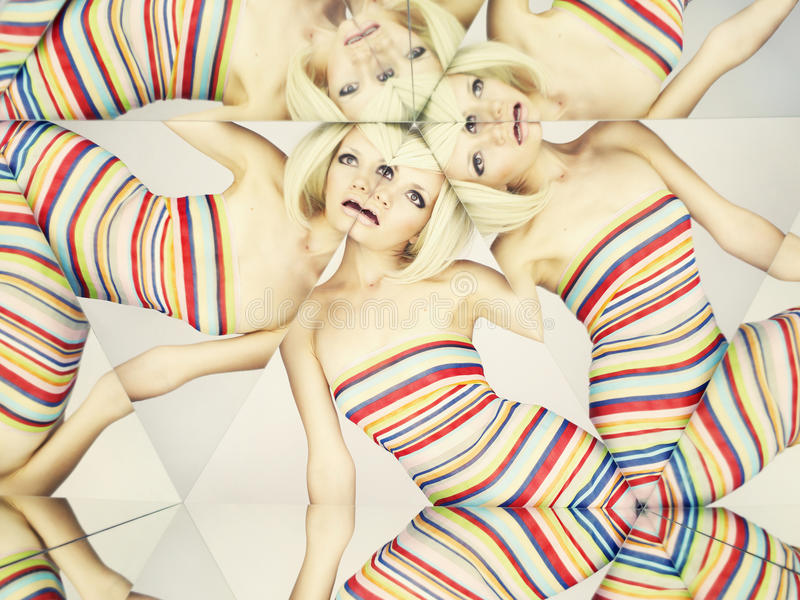 Bright blonde in kaleidoscope. Bright young blonde in kaleidoscope of reflections royalty free stock photography