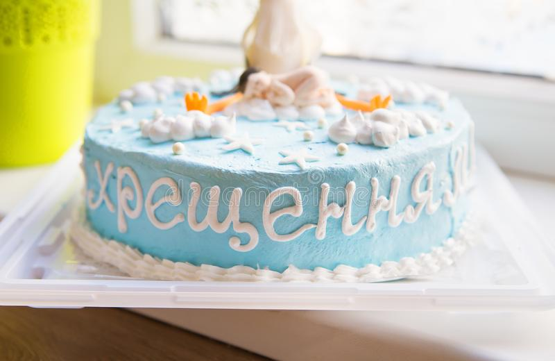 Bright blue baptized cake with a child and a stork-inscription baptism royalty free stock image
