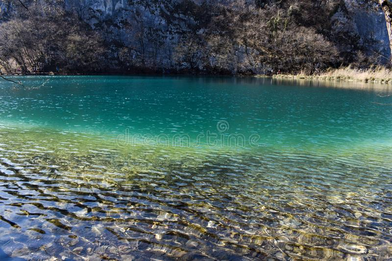 Bright blue fresh water at Plitvice Lakes in Croatia during early spring stock photography