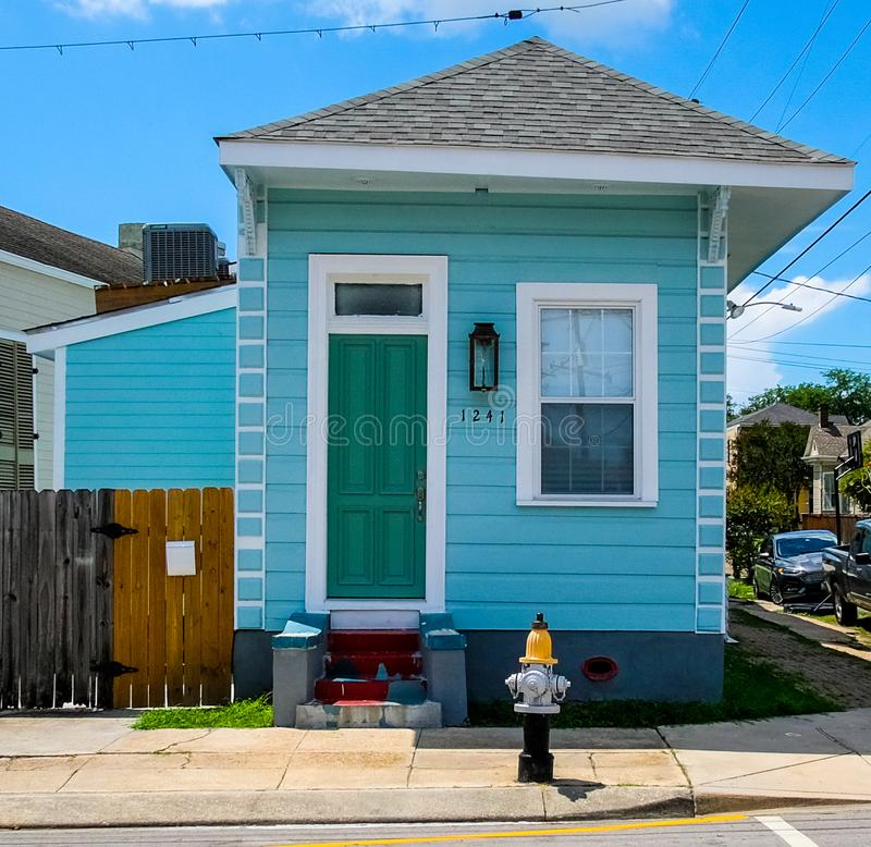 Bright Blue House in New Orleans, Louisiana 7th Ward. A bright blue colored house in New Orleans, Louisiana, USA 7th Ward Treme. Wood exterior with bright colors royalty free stock image