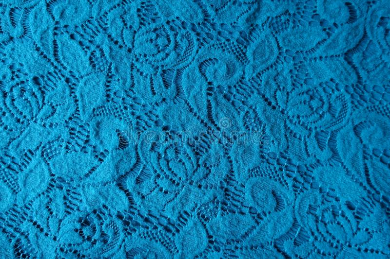 Bright blue lacy fabric from above. Bright blue cotton lacy fabric from above royalty free stock photography