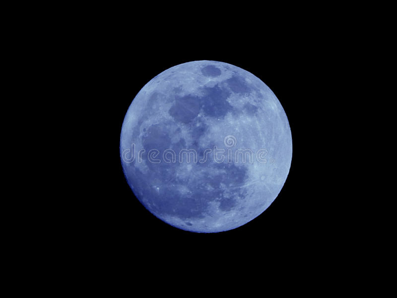 Bright Blue Moon Isolated on a Natural Black Night Sky royalty free stock photography