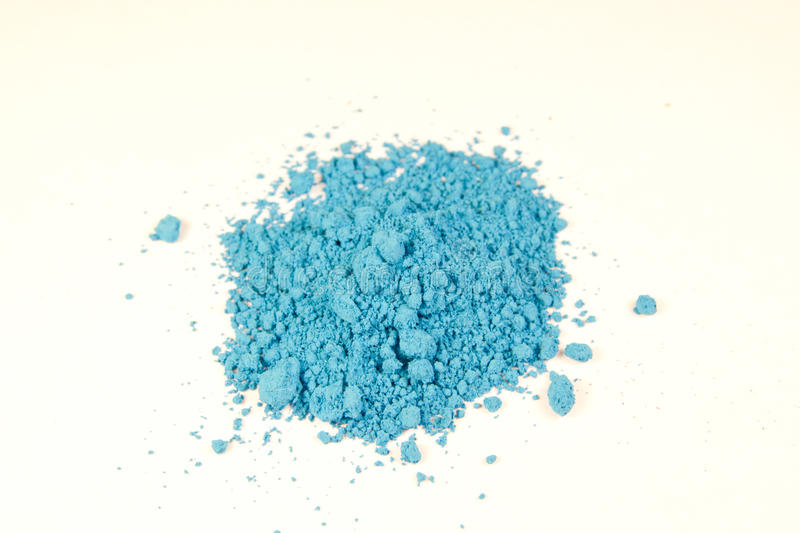 Bright blue pigment. Close up of a small portion of bright blue pigment over white stock images