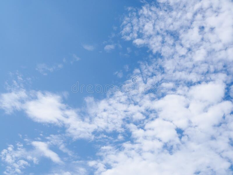 Bright blue skies with white fluffy clouds. Abstract backdrop wallpaper with Bright blue skies with white fluffy clouds royalty free stock image
