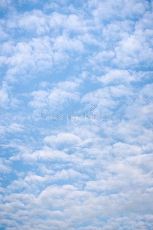 Bright blue sky with light feather white clouds stock photos