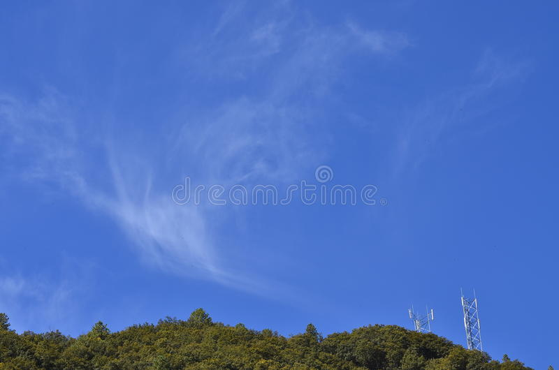 Bright blue sky with puffy white clouds. stock image