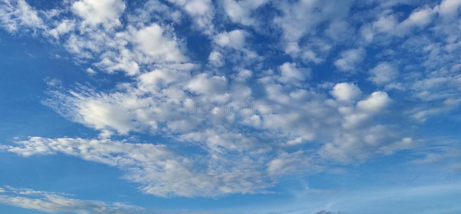Bright blue with small clouds floating sky looks beautiful royalty free stock images