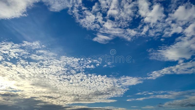 Bright blue with small clouds floating sky looks beautiful royalty free stock photography