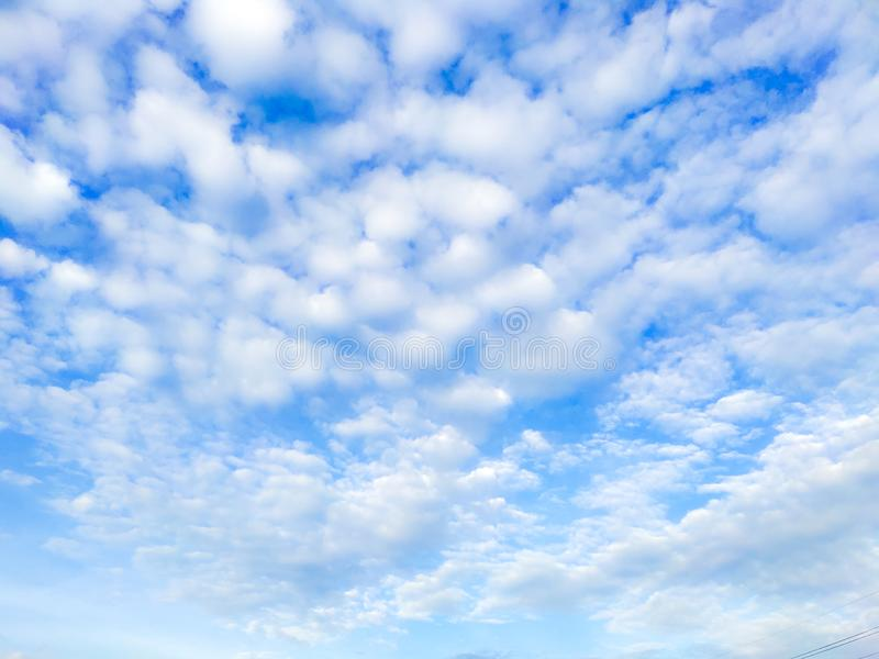 Bright blue with small clouds floating sky looks beautiful royalty free stock photo