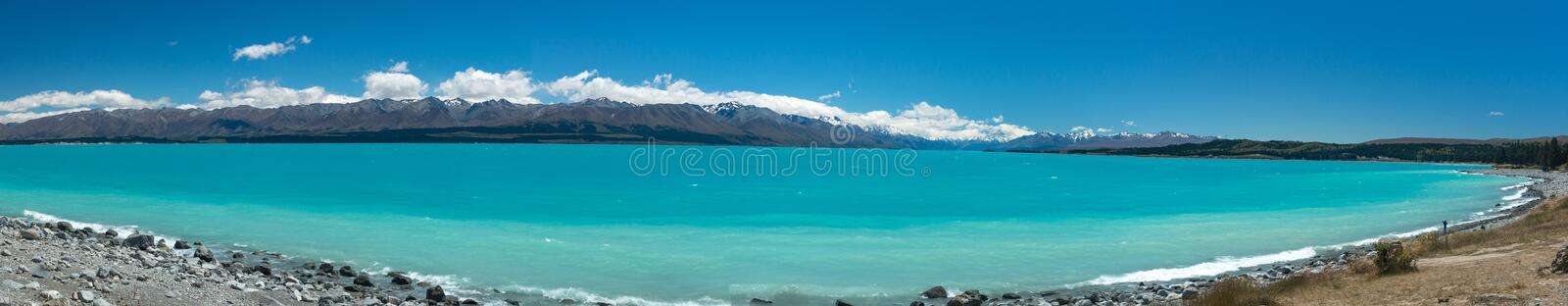 Bright blue waters of Lake Pukaki, a major tourist attraction on New Zealand`s South Island royalty free stock photo