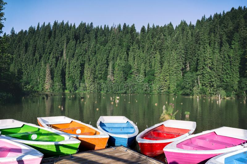 Bright boats on a mountain lake stock image