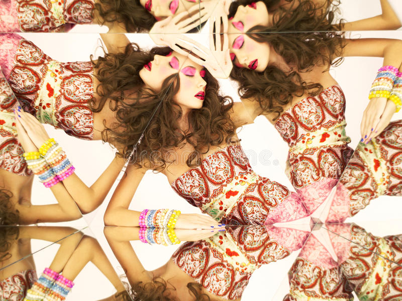 Bright brunette in kaleidoscope royalty free stock images