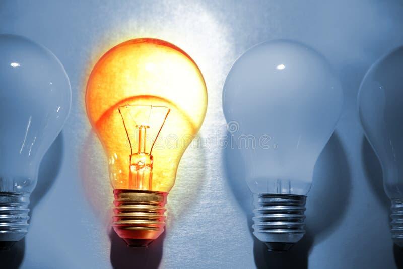Bright bulb. One bright bulb in crowd stock photo