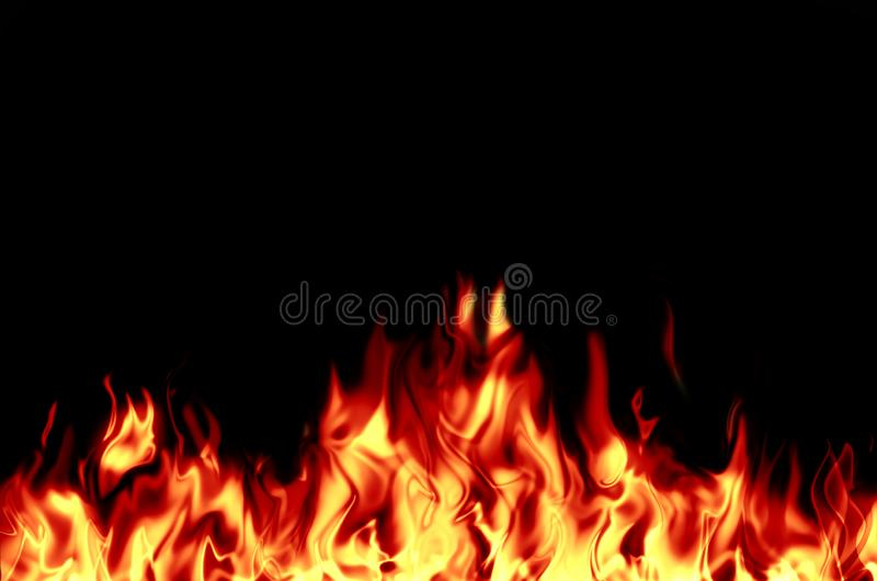 Bright, burning flame on a black background. stock image