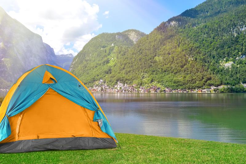 Bright camping tent near mountains. Bright camping tent at riverside near mountains stock image