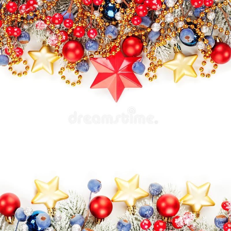 Bright Christmas card composition with red holly berries, Xmas tree branch, gold garland isolated on white background. Colorful Xmas decorations border royalty free stock images