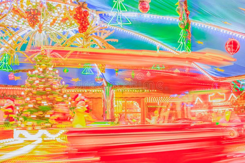 Bright christmas carrousel at the Christmas fair. Defocused xmas abstract. Blurred background. Bright christmas carrousel at the Christmas fair. Defocused xmas stock photos