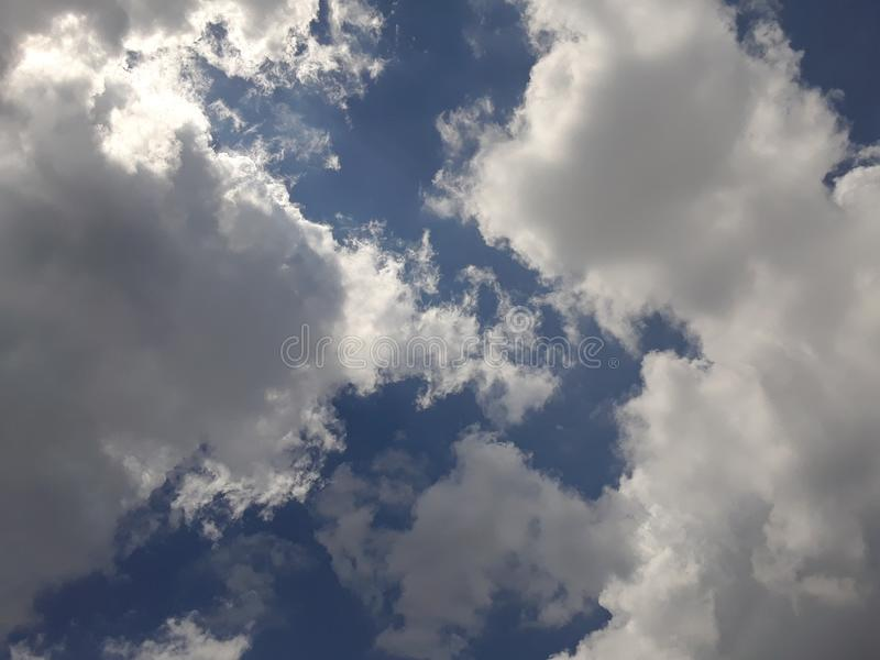 Bright cloudy blue skies overhead during the day 4. Bright cloudy blue skies overhead in the middle of the daytime stock photography
