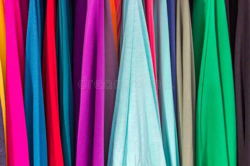 Bright color juicy fabrics of different shades. Light airy matter. Bright background.  stock images