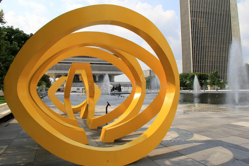 Bright color of yellow on interesting sculpture, Empire State Plaza,Albany,New York,2015. Interesting sculpture and architecture surround fountains along Empire stock photos