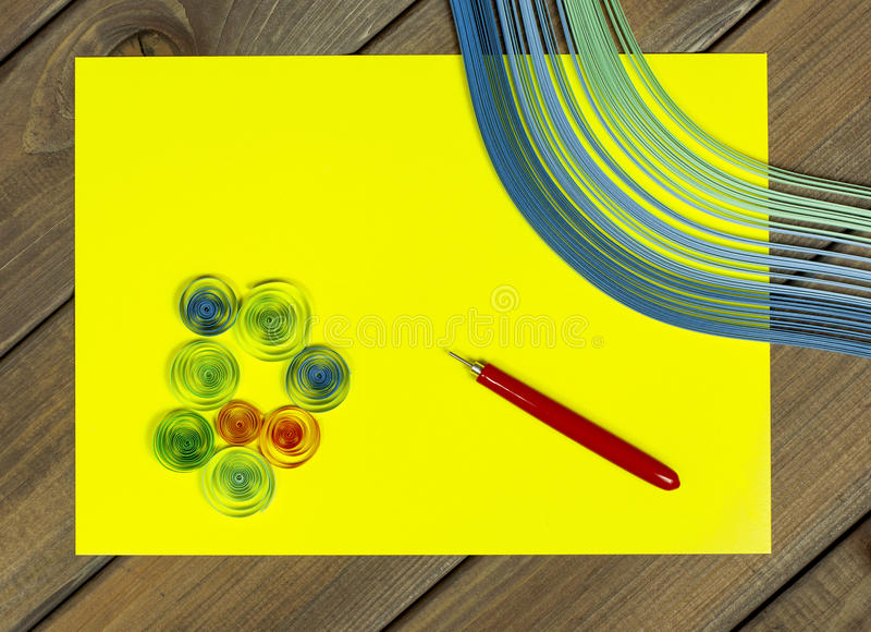 Bright colored background items for quilling (paper, ruler) royalty free stock photography