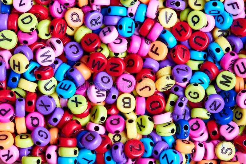 Bright colored beads with English letters close-up royalty free stock image