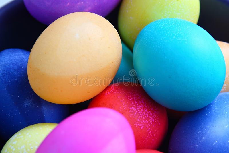 Bright colored Easter eggs piled together. stock images