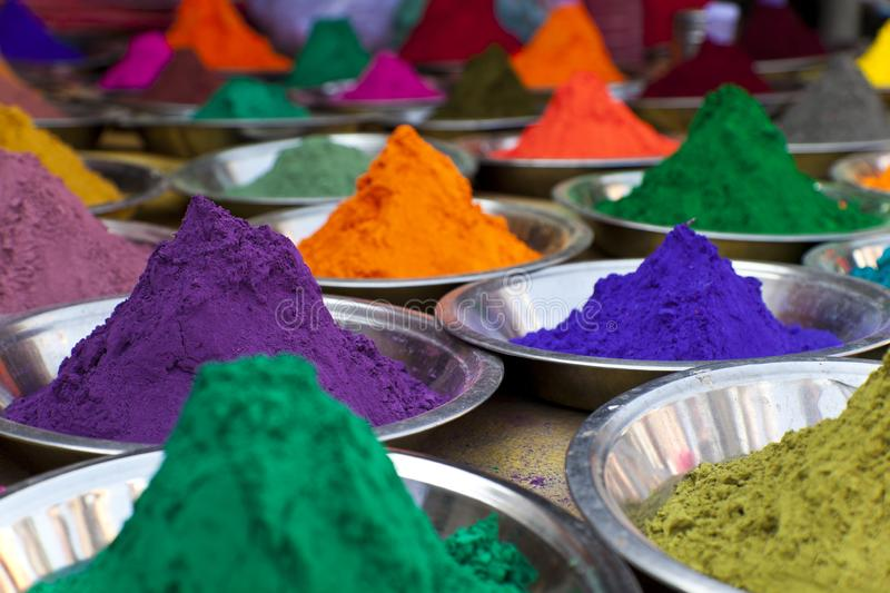 Bright colored paints in India.  Organic Gulal colours in bowl for Holi festival, Hindu tradition festive. Bright vibrant pigment. Closeup royalty free stock photo