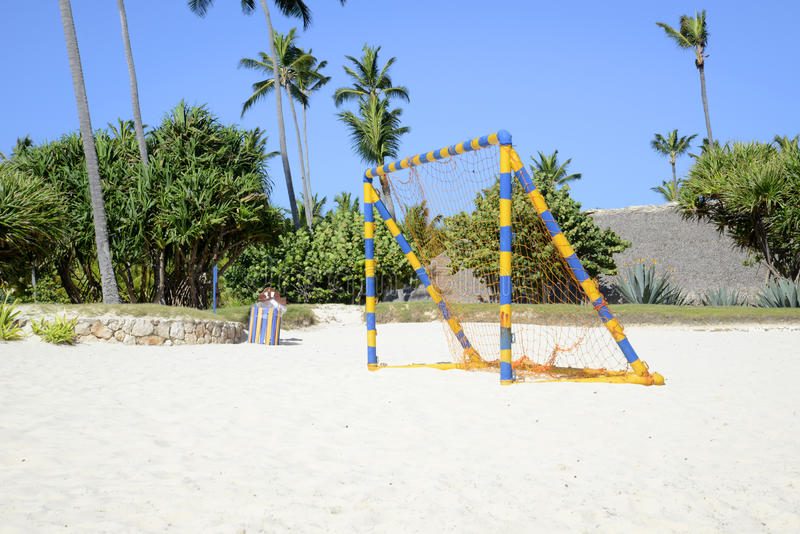 Bright colored soccer net on the beach royalty free stock photo