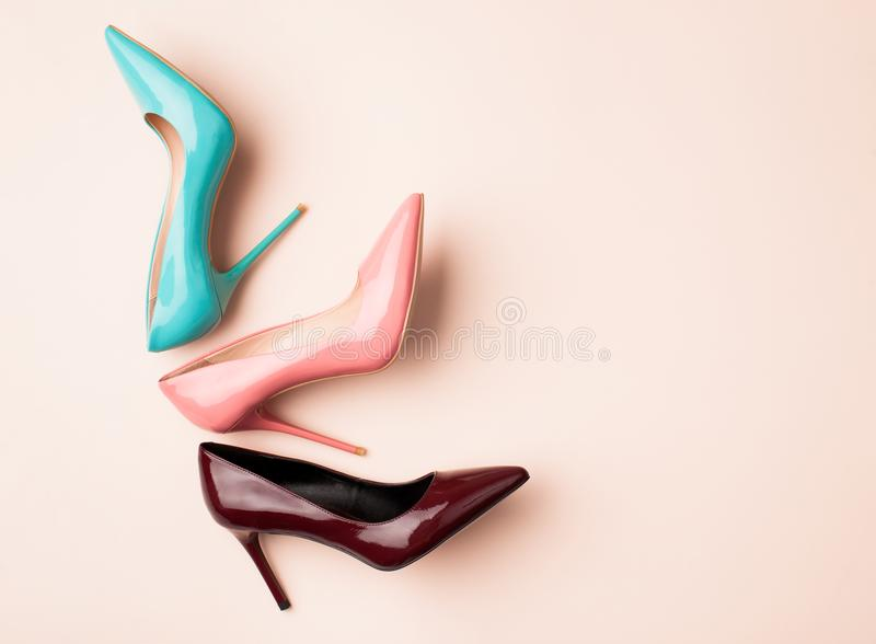 Set of colored women`s shoes on pink background. Bright colored women`s shoes on a solid background. Copy space text royalty free stock photography