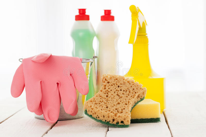 Bright colorful cleaning set on a wooden table
