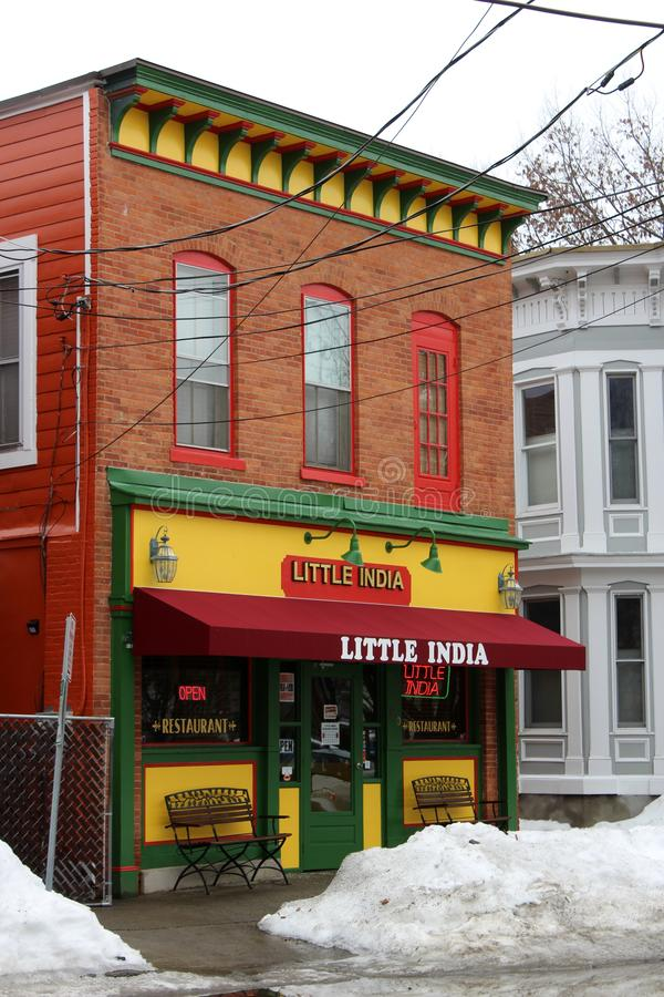 Bright and colorful facade of local Little India restaurant, Saratoga Springs, New York, 2019. Beautiful details in brick and wood architecture inviting people stock photo