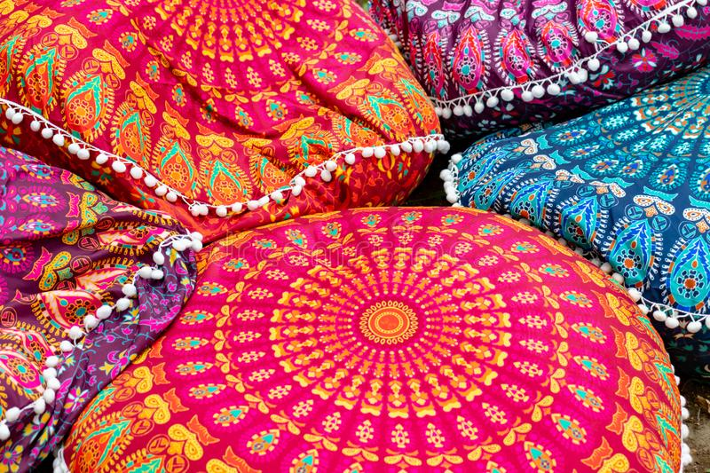 Bright colorful handmade ethnic traditional pillows background selling on a local asian market stock image