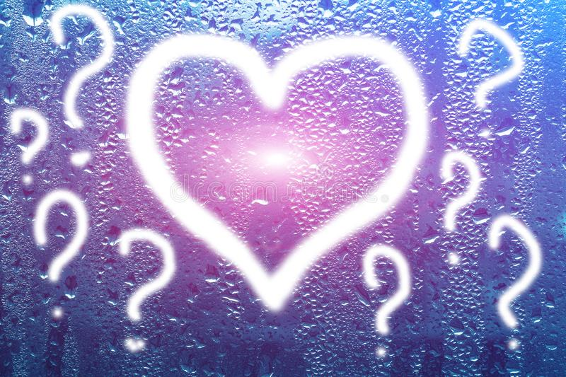 Bright colorful heart and the word love on the wet misted glass. royalty free stock images