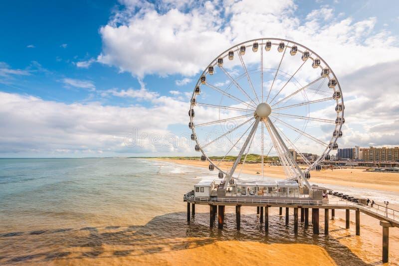 Ferris wheel on the beach of Scheveningen, North Sea, The Netherlands. stock photos