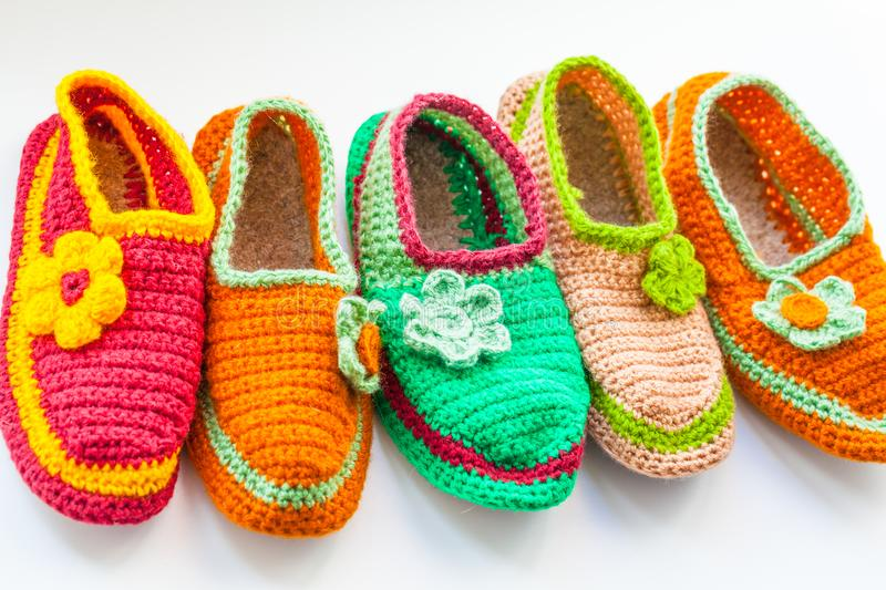 The Bright and Colorful knitted homemade slippers. The Bright and Colorful knitted homemade slippers royalty free stock photo