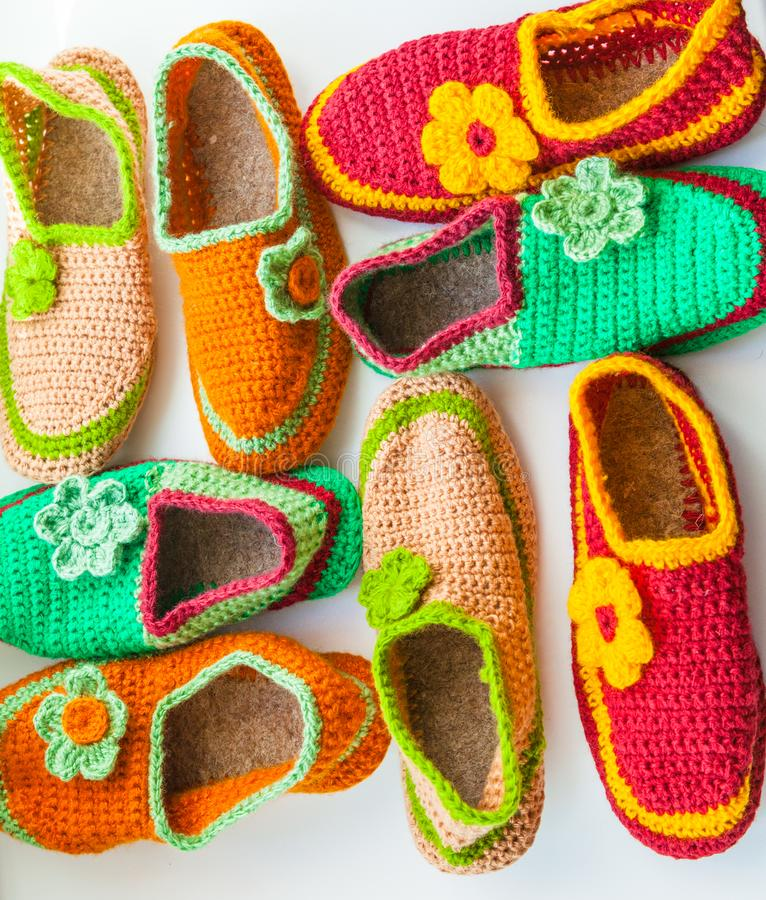 The Bright and Colorful knitted homemade slippers. The Bright and Colorful knitted homemade slippers royalty free stock image