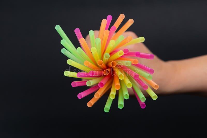 Bright colorful plastic straws line pattern artistic design stock photo