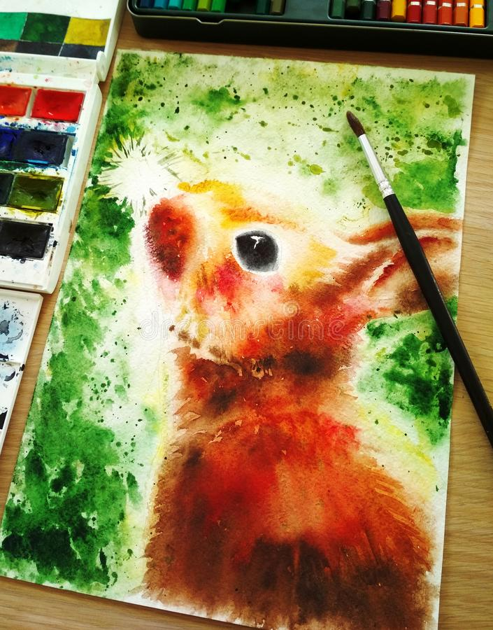 Bright colorful rabbit illustration on green background, painted by hand with watercolor. Vertical format, next to the. Bright colorful rabbit illustration on royalty free stock photos
