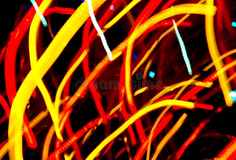 Bright colorful streaks. And flashes of lights on a dark background royalty free stock images