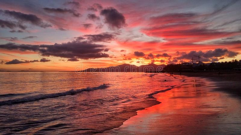 Red sunset over the atlantic ocean in puerto del carmen on lanzarote canary island in spain stock image