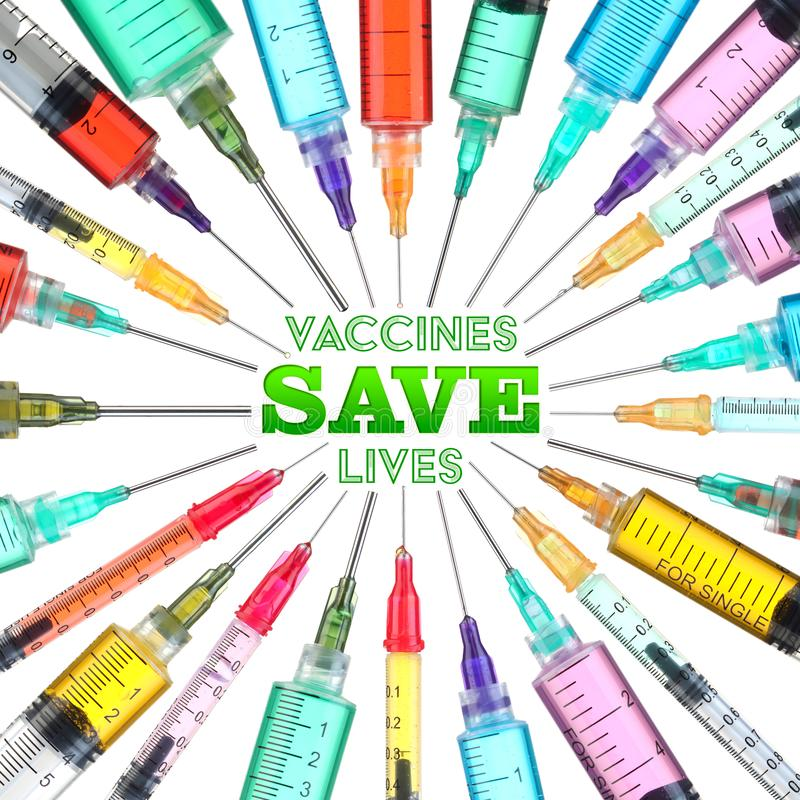 Bright and colorful syringes - Vaccines Save Lives. Bright and colorful syringes with Vaccines Save Lives text royalty free stock photography