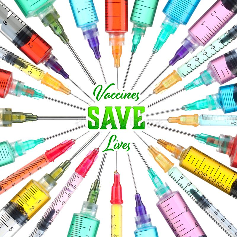 Colorful syringes - Vaccines Save Lives. Bright and colorful syringes - Vaccines Save Lives royalty free stock photo