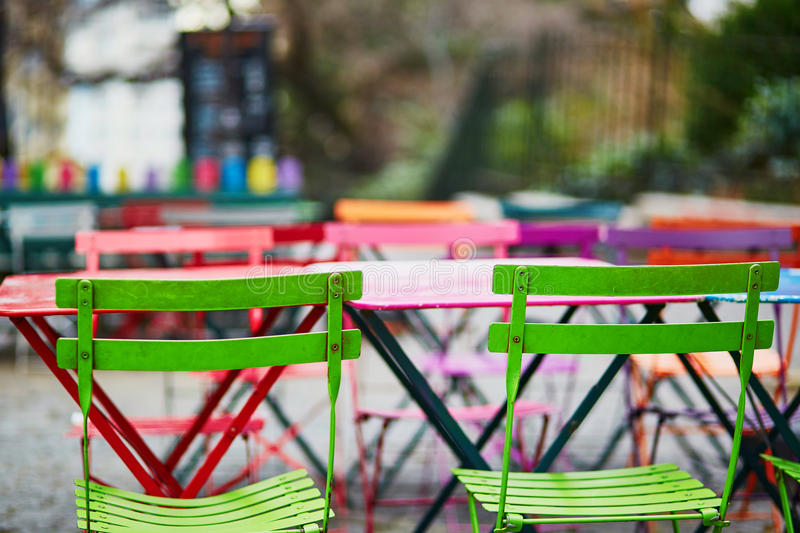 Bright colorful tables of Parisian outdoor cafe on Montmartre royalty free stock image