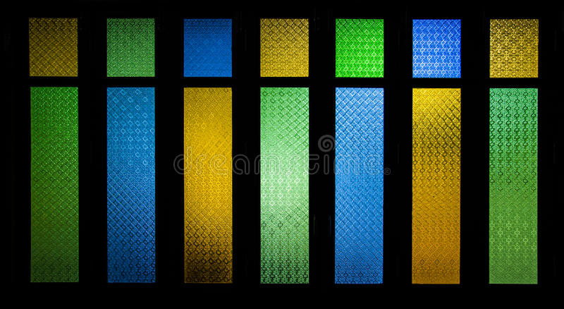 Bright and colorful texture from stain glass door. Art stock photo