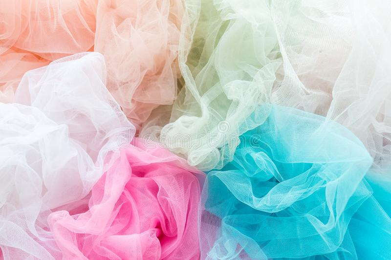 Bright and colorful tulle cloth closeup. Fabric for tutu skirt. Glamour fashionable clothes for woman and little girls. Bright and colorful tulle cloth closeup stock image