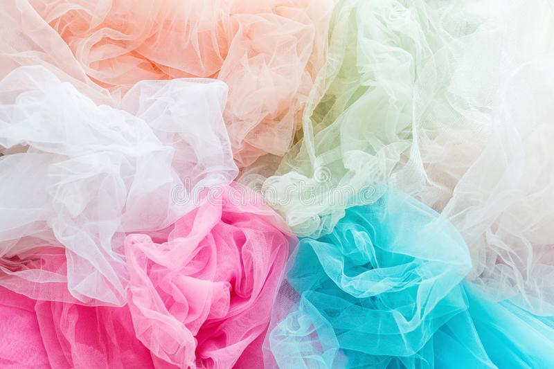 Bright and colorful tulle cloth closeup. Fabric for tutu skirt. Glamour fashionable clothes for woman and little girls. Bright and colorful tulle cloth closeup royalty free stock photography