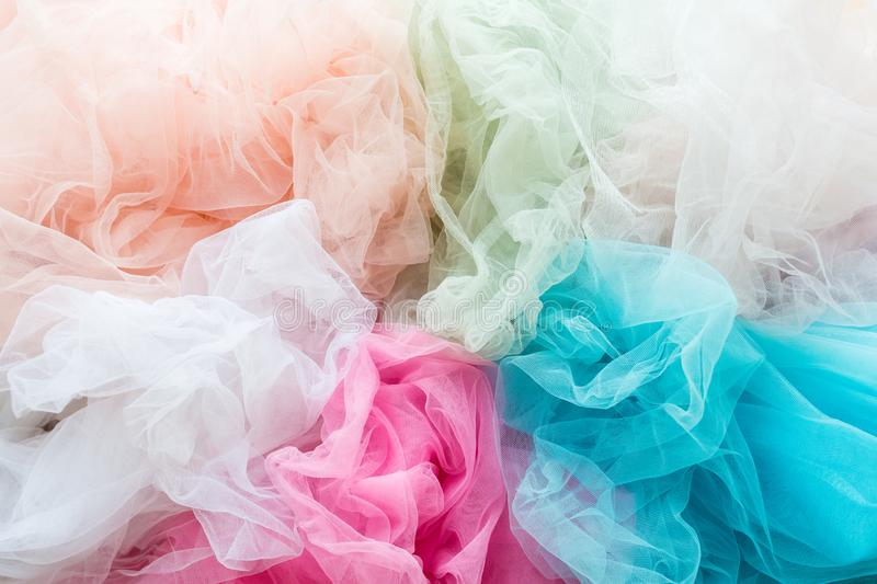 Bright and colorful tulle cloth closeup. Fabric for tutu skirt. Glamour fashionable clothes for woman and little girls. Bright and colorful tulle cloth closeup stock images